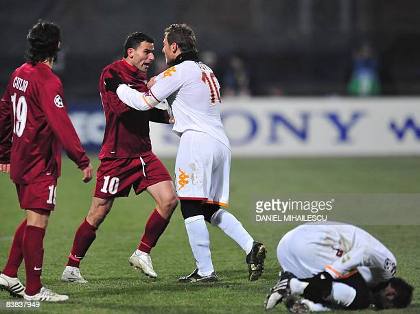 AS Roma's Francesco Totti argues against CFR Cluj's Eugen Trica as Trica tackeld Marco Cassetti during the Group stage of Champions League football...