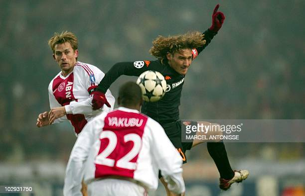 AS Roma's Francesco Totti fights for a ball with Ajax's Abubakari Yakubu and Andre Bergdoelmo during their Champions League match in the Amsterdam...