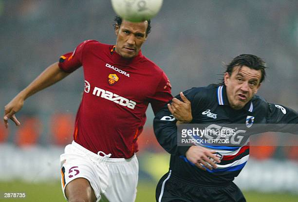Roma's French defender Jonathan Zebina vies with Sampdoria Genoa's forward Francesco Flachi during their Serie A soccer match 18 January 2004 at the...