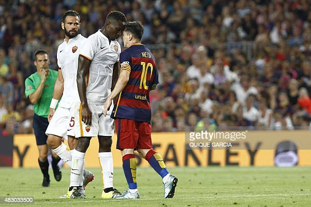 AS Roma's French defender Mapou YangaMbiwa and Barcelona's Argentinian forward Lionel Messi touch heads during the 50th Joan Gamper Trophy football...