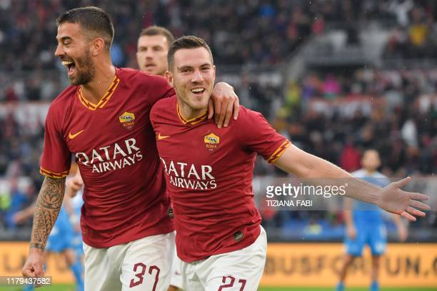 AS Roma's French midfielder Jordan Veretout celebrates with AS Roma's Italian defender Leonardo Spinazzola after scoring a goal during the Italian...