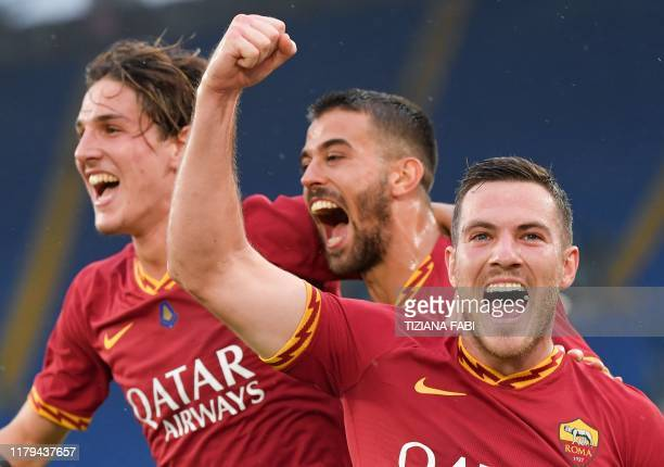 AS Roma's French midfielder Jordan Veretout celebrates with AS Roma's Italian midfielder Nicolo Zaniolo and AS Roma's Italian defender Leonardo...