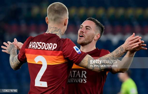 Roma's French midfielder Jordan Veretout celebrates with Roma's Dutch defender Rick Karsdorp after opening the scoring during the Italian Serie A...