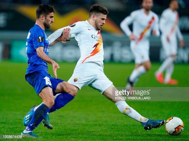 AS Roma's French midfielder Jordan Veretout fights for the ball with Ghent's Iranian defender Milad Mohammadi during the UEFA Europa League round of...