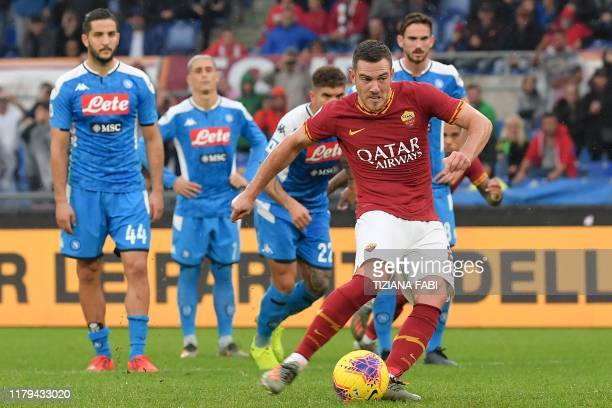 AS Roma's French midfielder Jordan Veretout kicks a penalty and scores a goal during the Italian Serie A football match between AS Roma and Napoli at...