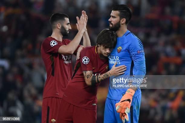 Roma's French midfielder Maxime Gonalons Roma's Italian forward Mirko Antonucci and Roma's Brazilian goalkeeper Alisson react at the end of the UEFA...