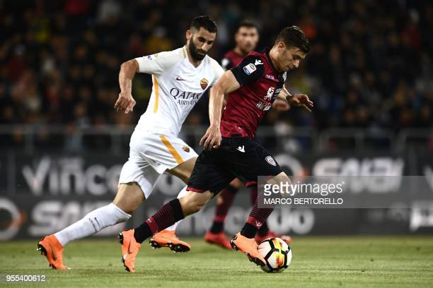AS Roma's French midfielder Maxime Gonalons vies for the ball with Cagliari's Italian midfielder Nicolo Barella during the Italian Serie A football...
