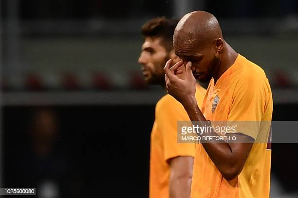 AS Roma's French midfielder Steven Nzonzi reacts at the end of the Italian Serie A football match AC Milan vs Roma on August 31 2018 at the 'San Siro...