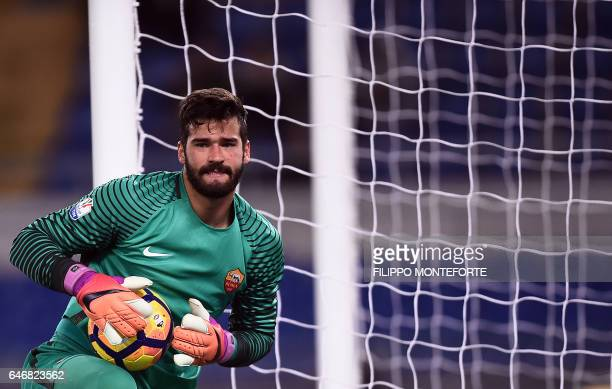 Roma's goalkeeper from Brazil Alisson makes a save during the Italian TIM Cup 1st leg semifinal football match on March 1 2017 at the Olympic stadium...