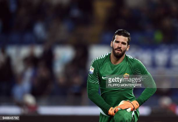 Roma's goalkeeper from Brazil Alisson Ramses Becker looks on during the Italian Serie A football match Lazio vs Roma at the Olympic Stadium in Rome...