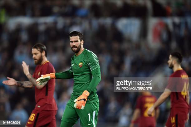 Roma's goalkeeper from Brazil Alisson Ramses Becker reacts during the Italian Serie A football match between Lazio and Roma on April 15 2018 at...