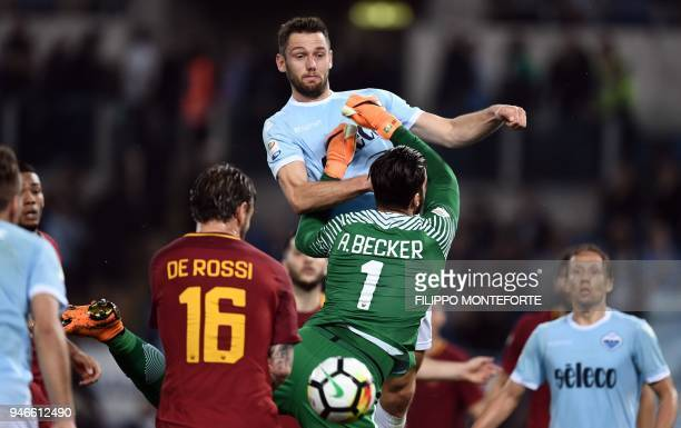 Roma's goalkeeper from Brazil Alisson Ramses Becker vies for the ball with Lazio's defender from the Netherlands Stefan de Vrij during the Italian...