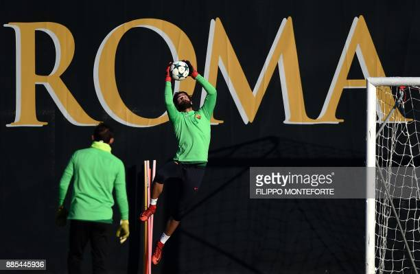 Roma's goalkeeper from Brazil Alisson take part in a training session on the eve of the UEFA Champions League football match AS Roma vs Qarabag on...