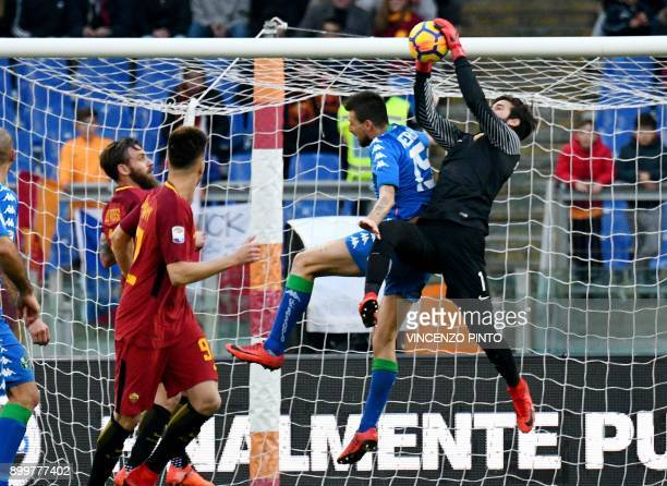 AS Roma's goalkeeper from Brazil Allison controls the ball over Sassuolo's defender from Italy Francesco Acerbi during the Italian Serie A football...