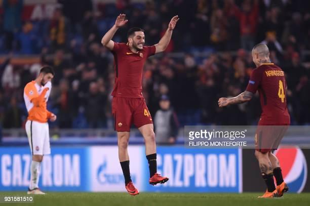 Roma's Greek defender Kostas Manolas and Roma's Belgian midfielder Radja Nainggolan celebrate afer winning 10 the UEFA Champions League round of 16...