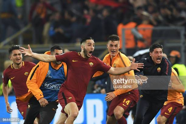 Roma's Greek defender Kostas Manolas celebrates after scoring a goal during the UEFA Champions League quarterfinal second leg football match between...