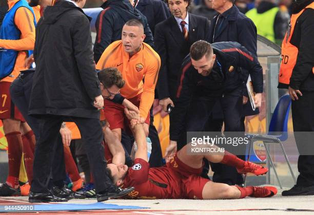 Roma's Greek defender Kostas Manolas is celebrated by teammates after scoring a goal during the UEFA Champions League quarterfinal second leg...