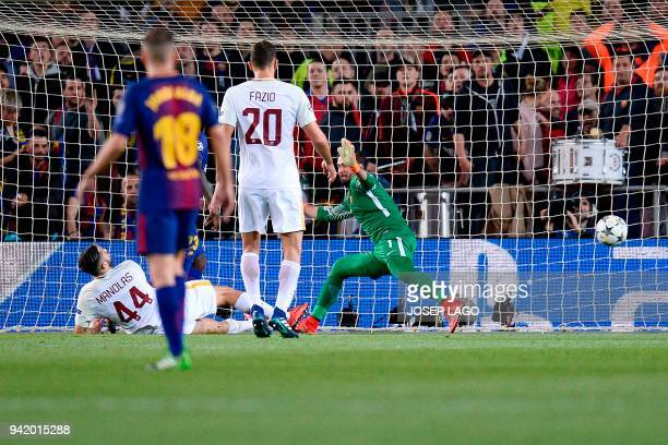 Roma's Greek defender Kostas Manolas scores an own goal during the UEFA Champions League quarterfinal first leg football match between Barcelona and...