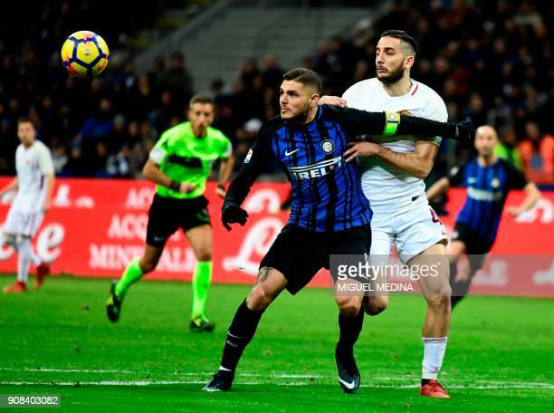 Roma's Greek defender Kostas Manolas vies with Inter Milan's Captain Argentinian forward Mauro Icardi during the Italian Serie A football match Inter...