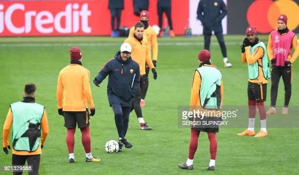 Romas head coach Eusebio Di Francesco and players take part in the training session at the Metalist stadium in Kharkiv on February 20 2018 on the eve...
