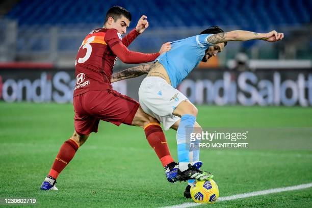 Roma's Italian defender Gianluca Mancini and Lazio's Spanish midfielder Luis Alberto go for the ball during the Italian Serie A football match Lazio...