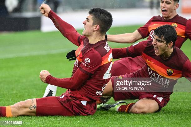 Roma's Italian defender Gianluca Mancini celebrates after scoring an equalizer during the Italian Serie A football match AS Rome vs Inter Milan on...