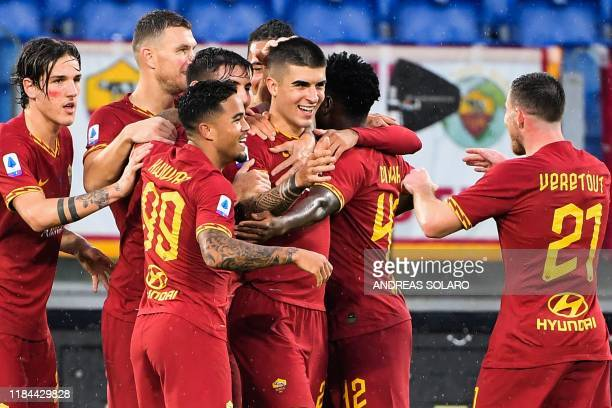 AS Roma's Italian defender Gianluca Mancini celebrates with teammates after scoring during the Italian Serie A football match Roma vs Brescia on...