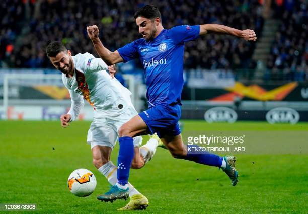 AS Roma's Italian defender Leonardo Spinazzola is challenged by Ghent's Iranian defender Milad Mohammadi during the UEFA Europa League round of 32...