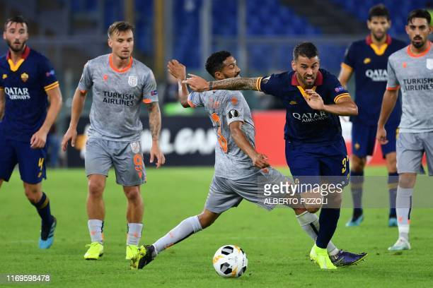Roma's Italian defender Leonardo Spinazzola outruns Istanbul Basaksehir FK's French defender Gael Clichy during the UEFA Europa League Group J...