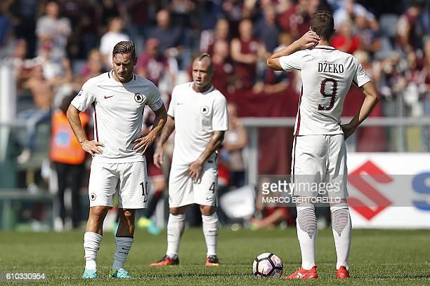 AS Roma's Italian forward Francesco Totti and Bosnian forward Edin Dzeko react during the Italian Serie A football match between Torino and AS Roma...