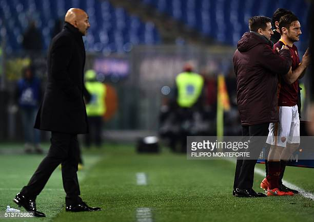 Roma's Italian forward Francesco Totti prepares to enter the pitch as Roma's Italian coach Luciano Spalletti looks on during the Italian Serie A...