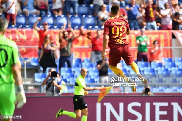 Roma's Italian forward Stephan El Shaarawy celebrates after opening the scoring during the Italian Serie A football match AS Rome vs Chievo Verona on...