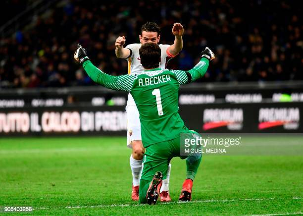 Roma's Italian forward Stephan El Shaarawy celebrates with Roma's Brazilian goalkeeper Alisson Ramses Becker after scoring a goal during the Italian...
