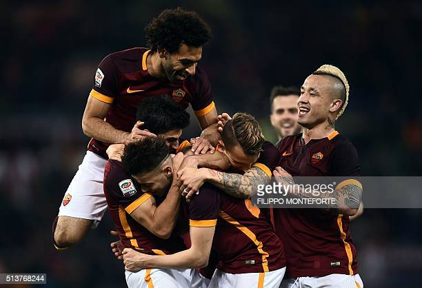 Roma's Italian forward Stephan El Shaarawy celebrates with teammates after scoring a goal during the Italian Serie A football match AS Roma vs ACF...