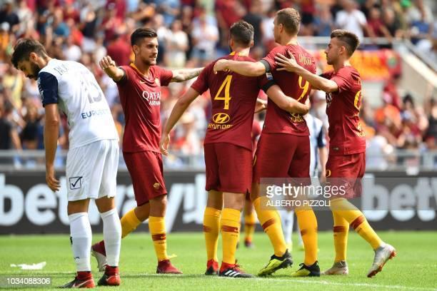 Roma's Italian forward Stephan El Shaarawy Roma's Bosnian forward Edin Dzeko Roma's Italian midfielder Bryan Cristante and Roma's Italian midfielder...