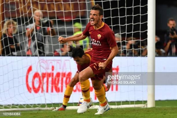 Roma's Italian midfielder Alessandro Florenzi celebrates after scoring during the Italian Serie A football match Roma vs Atalanta at Rome's Olympic...