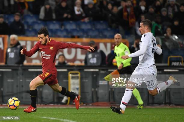 Roma's Italian midfielder Alessandro Florenzi drives the ball next to Cagliari's midfielder from Italy Simone Padoin during the Italian Serie A...