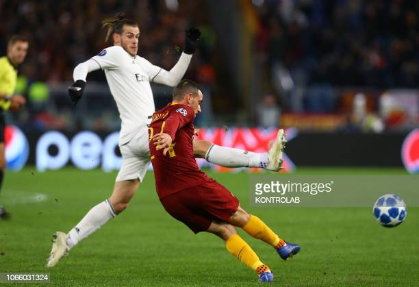 Roma's Italian midfielder Alessandro Florenzi fights for the ball with Real Madrid's Welsh forward Gareth Bale during the UEFA Champions League...