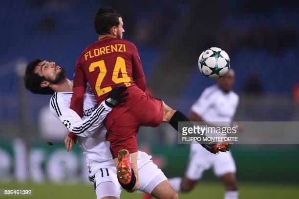 Roma's Italian midfielder Alessandro Florenzi fights for the ball with Qarabag's Azerbaijani forward Mahir Madatov during the UEFA Champions League...
