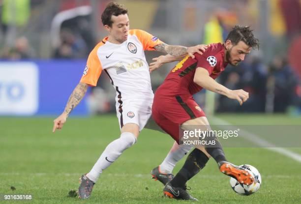 Roma's Italian midfielder Alessandro Florenzi fights for the ball with FC Shakhtar's Brazilian midfielder Bernard during the UEFA Champions League...