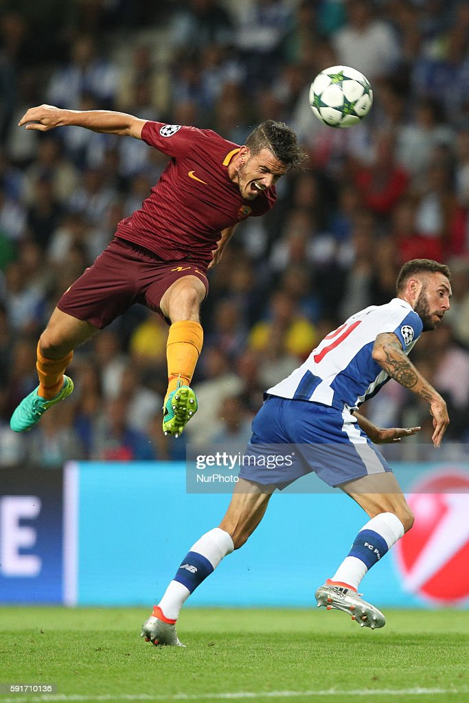 Roma's Italian midfielder Alessandro Florenzi (L) in action with Porto's Mexican defender Miguel Layun (R) during the UEFA Champions League match between FC Porto and AS Roma, at Dragao Stadium in Porto on August 17, 2016.