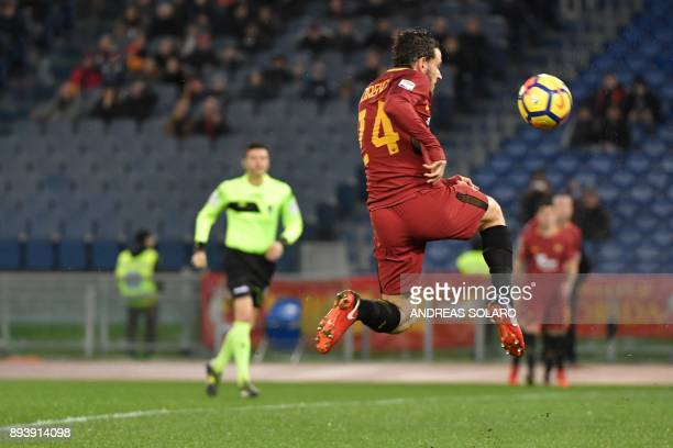 Roma's Italian midfielder Alessandro Florenzi jumps for the ball during the Italian Serie A football match Roma vs Cagliari on December 16 2017 at...