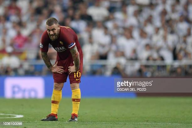 Roma's Italian midfielder Daniele De Rossi bends during the UEFA Champions League group G football match between Real Madrid CF and AS Roma at the...