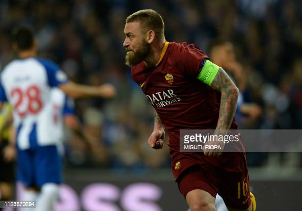 AS Roma's Italian midfielder Daniele De Rossi celebrates after scoring a goal during the UEFA Champions League round of 16 second leg football match...