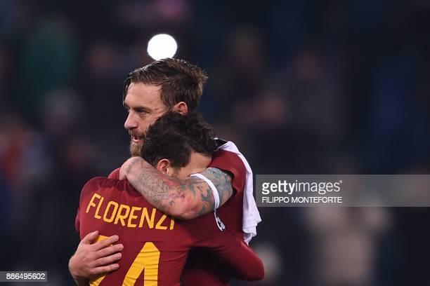 Roma's Italian midfielder Daniele De Rossi celebrates with Roma's Italian midfielder Alessandro Florenzi at the end of the UEFA Champions League...