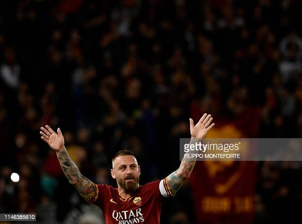 TOPSHOT Roma's Italian midfielder Daniele De Rossi is acknowledged by fans during his farewell to Roma after 18 years at his hometown club at the end...