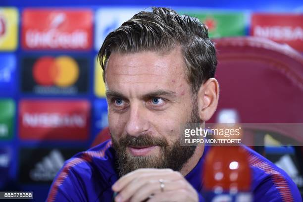 Roma's Italian midfielder Daniele De Rossi smiles during a press conference on the eve of the UEFA Champions League football match AS Roma vs Qarabag...
