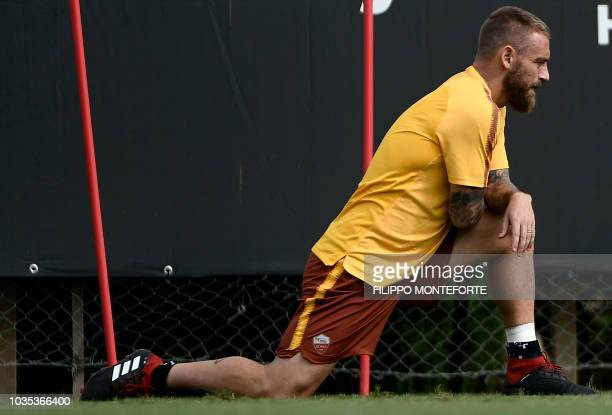 Roma's Italian midfielder Daniele De Rossi stretches during a training session at the Trigoria training ground in the outskirts of Rome on September...