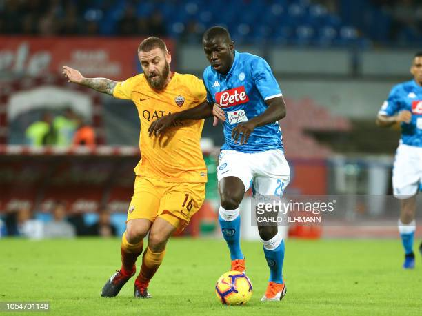 Roma's Italian midfielder Daniele De Rossi vies for the ball with Napoli's defender from France Kalidou Koulibaly during the Italian Serie A football...