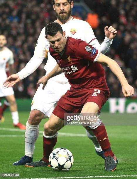 Roma's Italian midfielder Daniele De Rossi vies with Liverpool's English midfielder James Milner during the UEFA Champions League first leg semifinal...